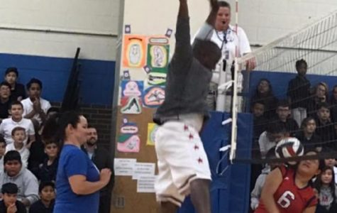 Mr. Batie spikes the winning point over the net